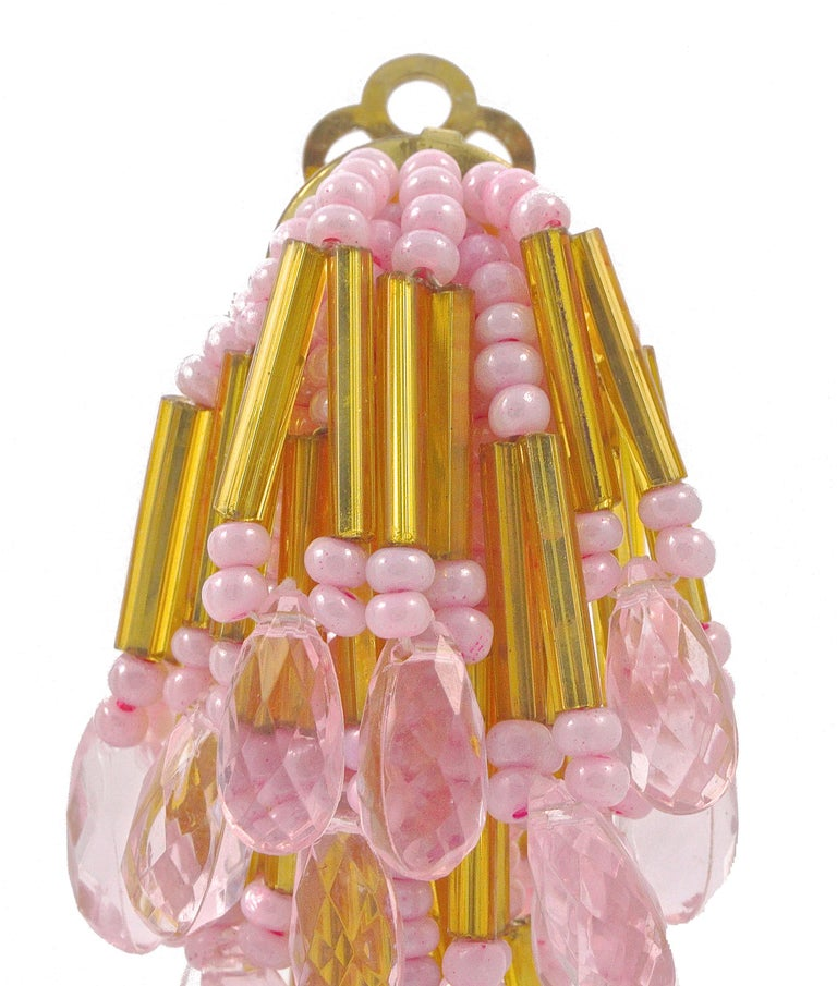 Fabulous gold tone clip on chandelier earrings, featuring strands of pink and gold beads. Measuring length 7.6cm / 3 inches. The earrings are light to wear, the pink and gold beads are glass and the drops are plastic.  These are stunning vintage