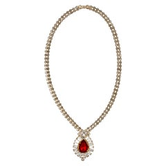 Gold Tone Pendant Necklace with Clear Rhinestones and a Red Rhinestone Teardrop