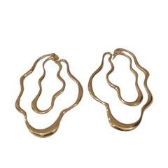 Gold tone silver Waves earrings NWOT