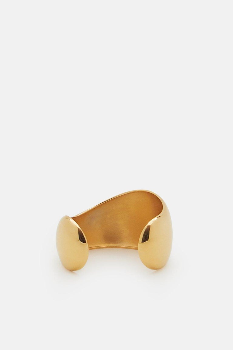 AGMES Gold Vermeil Curved Organic Cuff Bracelet. Handmade in NYC.   Inspired by urban landscapes, architecture and modern art, the collection creates a feminine geometry expressed through clean lines and sculptural silhouettes.