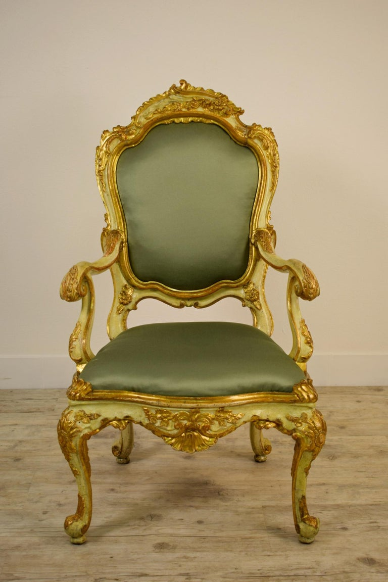 Finely golden and lacquered wood Venetian armchair, 18th century.