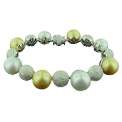 Golden and White South Sea Pearls with Pave Diamond Balls