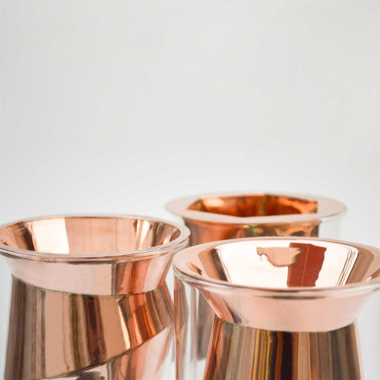 Project that takes as its starting point luxury and austerity to develop a line of objects that explores the boundaries between function and ornament. The golden vases, are compound by low cost glass bases, and in the top of them, metal handmade