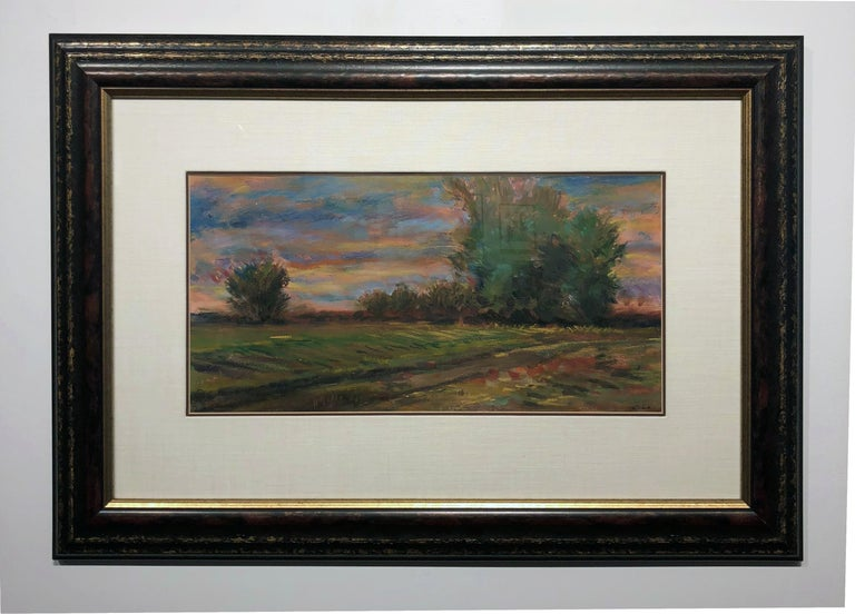 This serene impressionist landscape painting of a rural scene is created in soft pastel. The lush surface perfectly compliments the golden hues in the sky and the velvety earth and trees. Beautifully framed and matted.  Xiao Landscape,