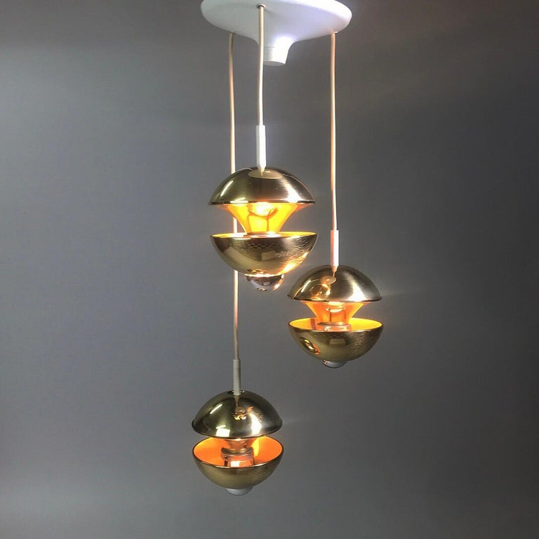 Beautiful golden brass chandelier with three light sources made by renowned lighting company Kaiser Leuchten, Germany, 1970s.  The rare piece is made of solid brass and due the the use of mirror bulbs (they designed the light to be used with