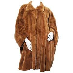 Golden lightweight sheared mink cape coat by Elena Benarroch