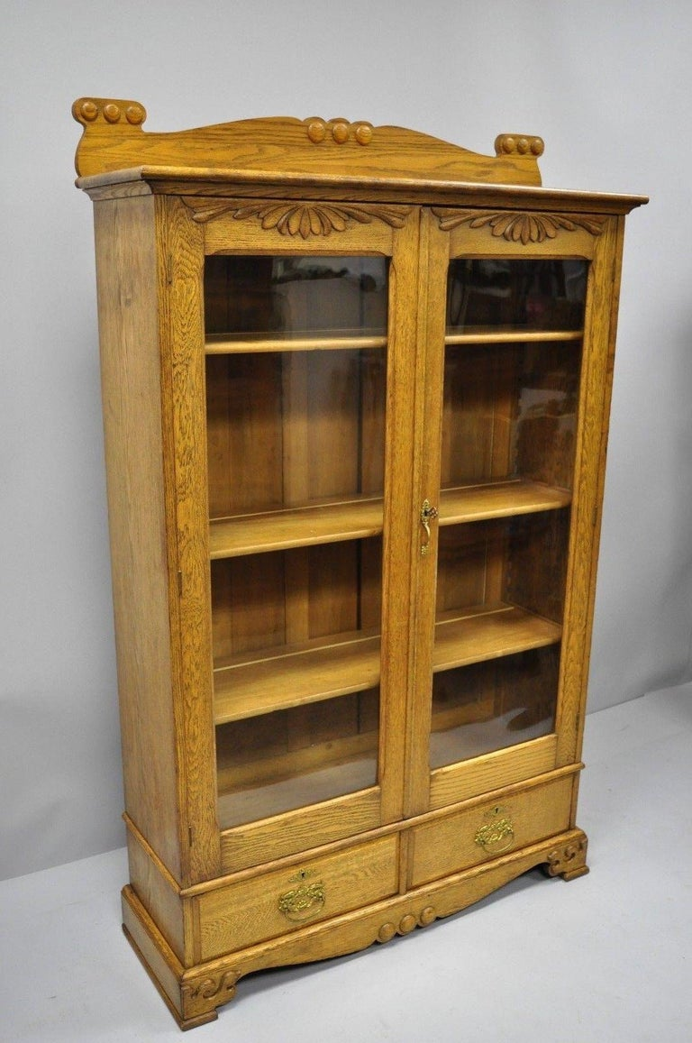 Golden Oak Victorian Glass Two-Door Bookcase China Cabinet Curio Two Drawers For Sale 7