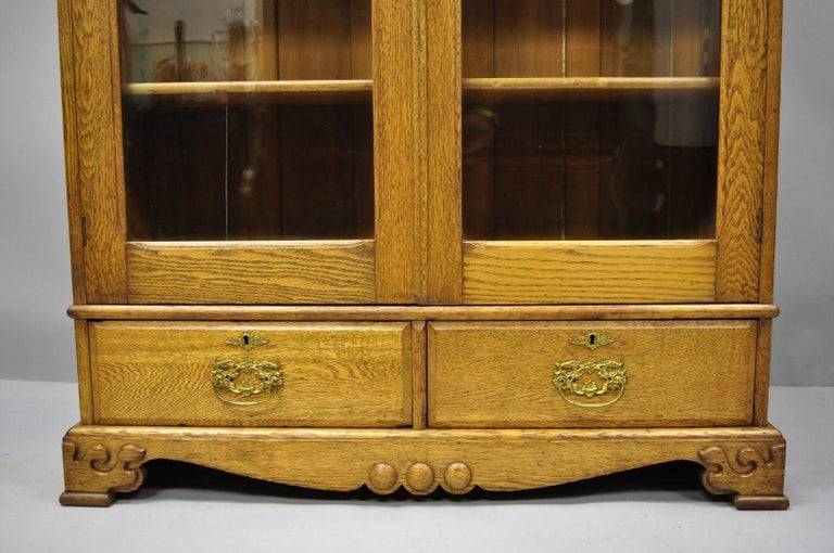 Golden Oak Victorian Glass Two-Door Bookcase China Cabinet Curio Two Drawers In Good Condition For Sale In Philadelphia, PA