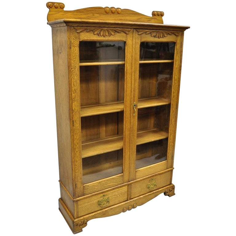 Golden Oak Victorian Glass Two-Door Bookcase China Cabinet Curio Two Drawers For Sale