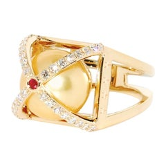 Golden South Sea Pearl Embraced with Diamond and 14 Ky Gold with a Ruby on Top