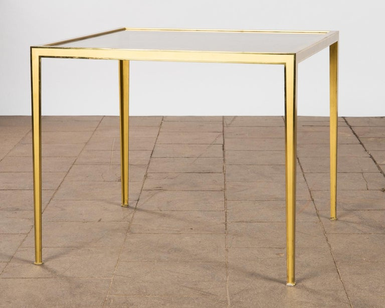 Golden Mid-Century Modern square Brass coffee table by Vereinigte Werkstätten  Coffee or side table produced by German company Vereinigte Werkstätten München in the 1960s. The table is made of brushed messing, the top is made of smoked glass. Good