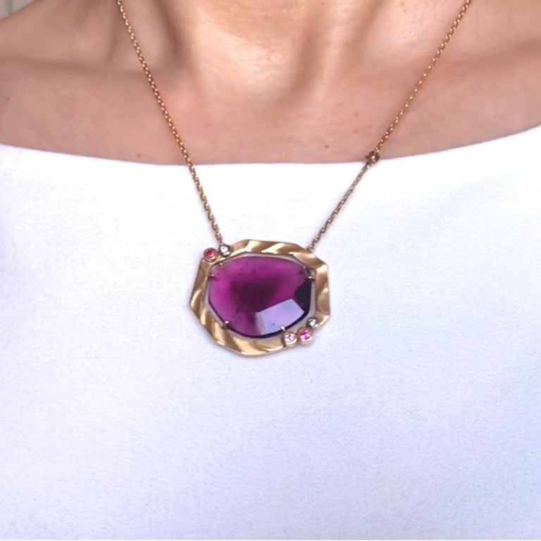 The lovely Sweet Briar flowers of northern Japan where Keiko Mita spent her childhood inspired her to create the Golden Sweetbriar Pendant. The spectacular 15ct Pink Tourmaline (approximate weight), which has striking inclusions that create a watery