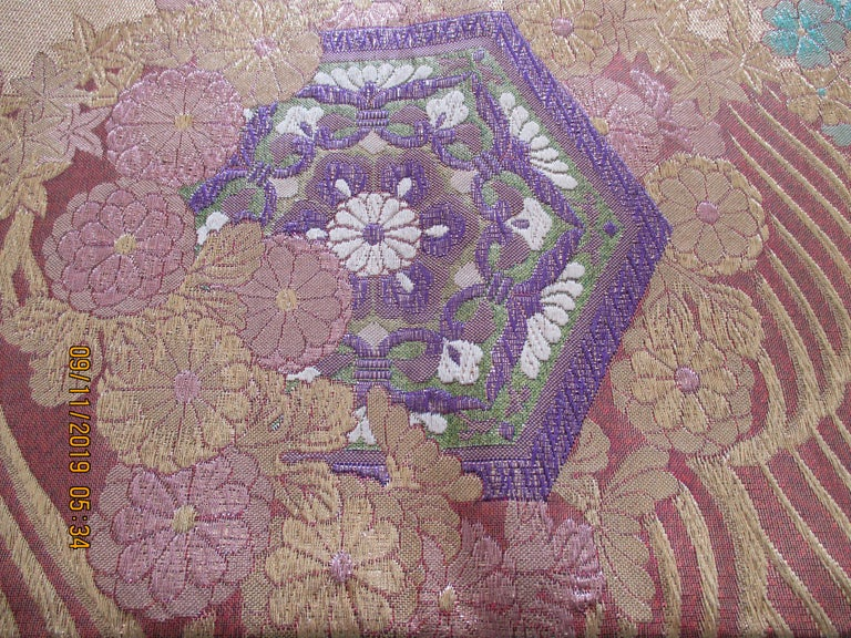 Golden textured woven Obi textile depicting flowers in bloom, in shades of deep purple, gold, lavender, green, white, pink and aqua Ideal for pillows or upholstery. Size: 12