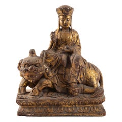 Golden Wooden Buddhist Deity, Seated on a Lion, China, Late 19th Century