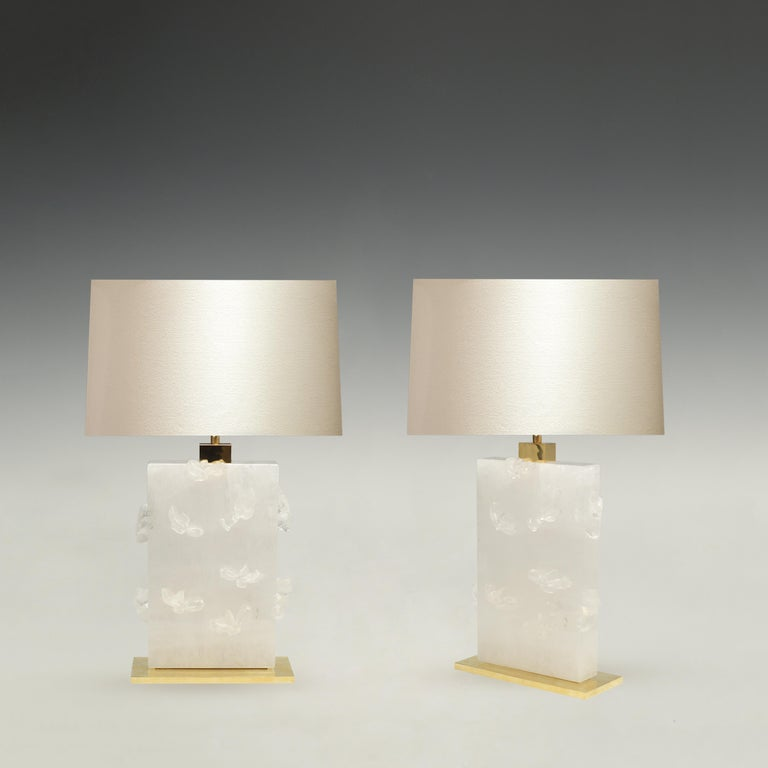 Pair of fine carved swimming goldfish rock crystal lamps with polish brass decoration. Created by Phoenix. To the top of rock crystal is 13.5 in. Each lamp installs two sockets. Lampshades do not include.
