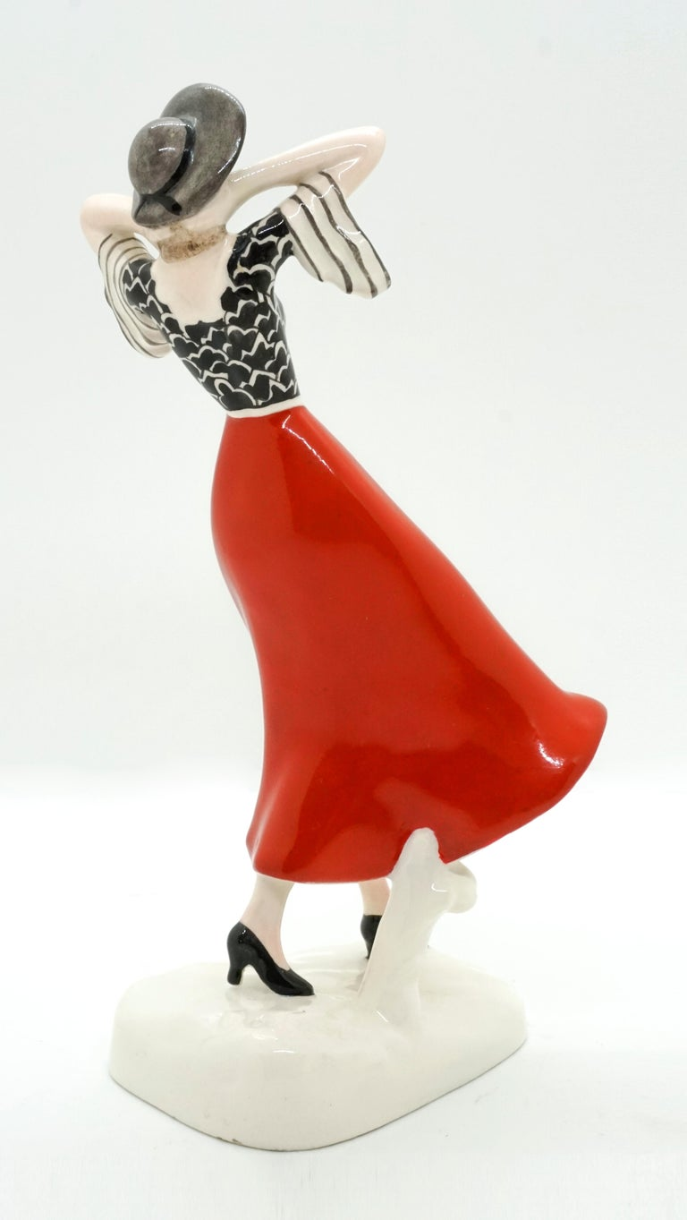 Austrian Goldscheider Vienna Art Deco Girl with Hat in the Wind by Stephan Dakon For Sale