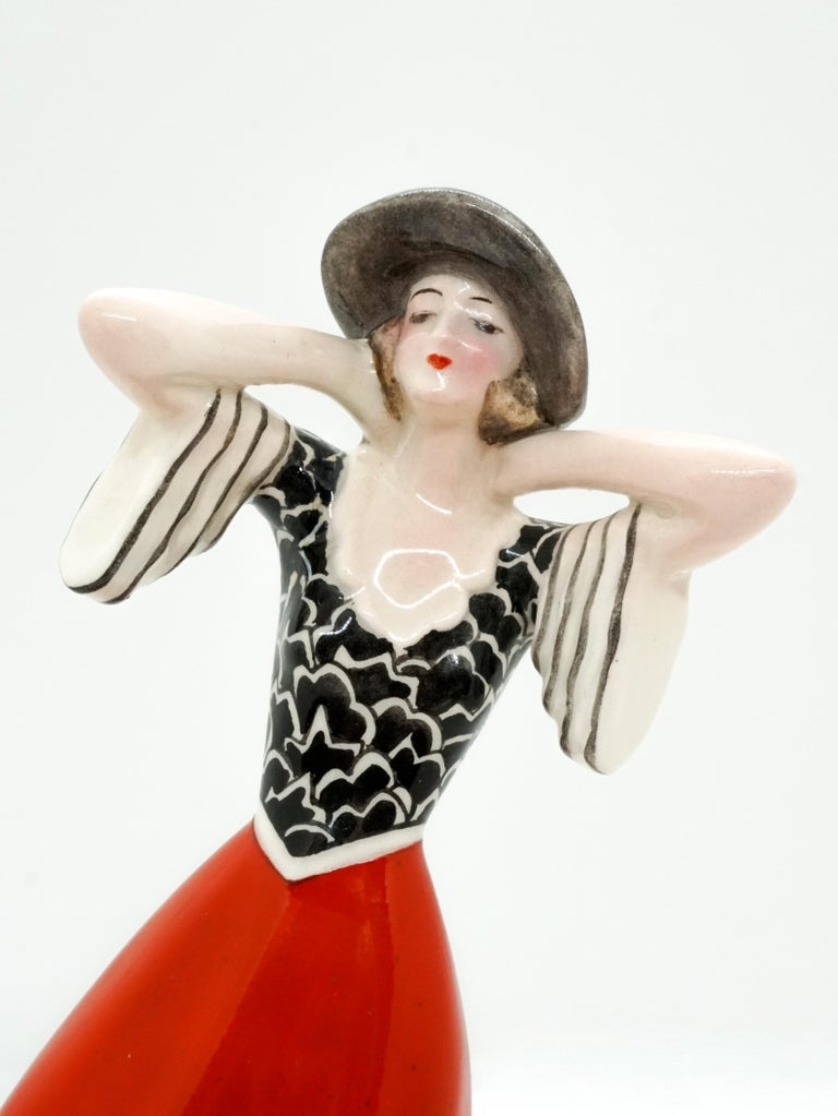 Mid-20th Century Goldscheider Vienna Art Deco Girl with Hat in the Wind by Stephan Dakon For Sale