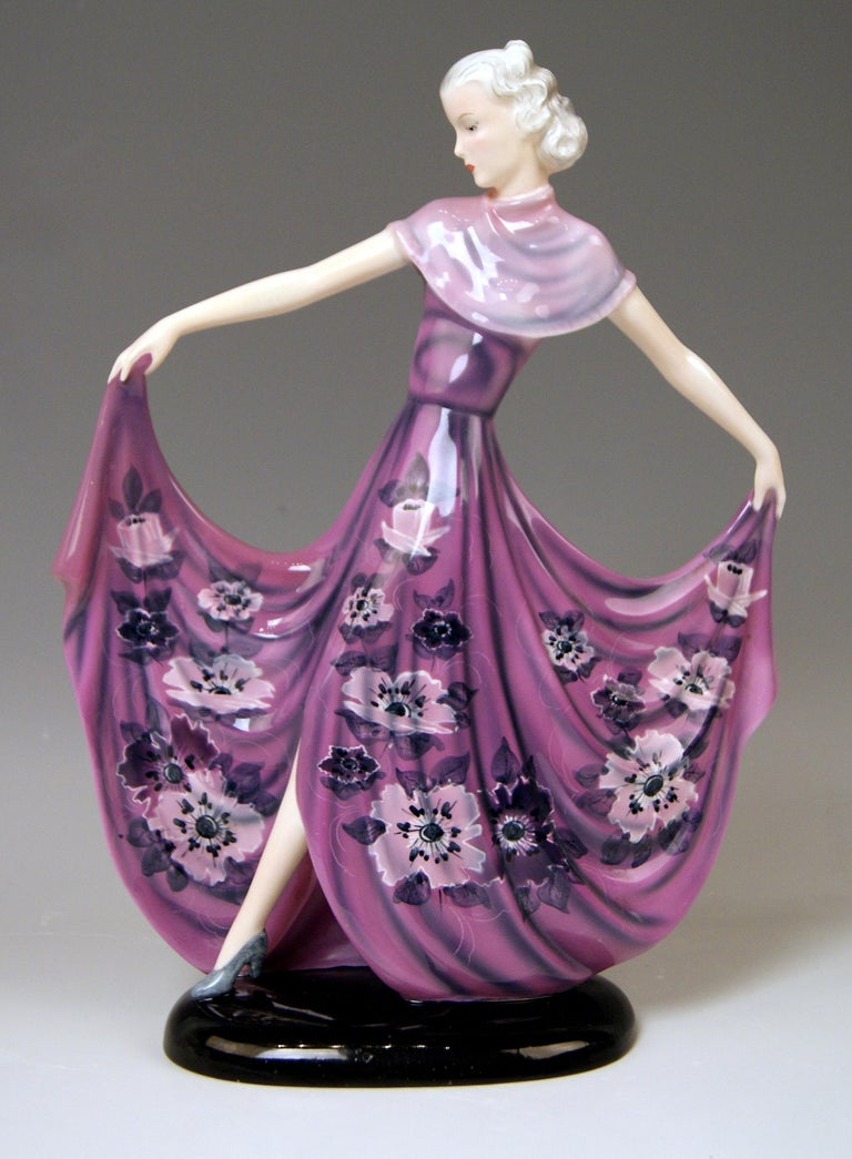 Goldscheider Vienna dancing lady wearing rarely painted dress, decorated with nicest stylized flowers' pattern: This figurine - called