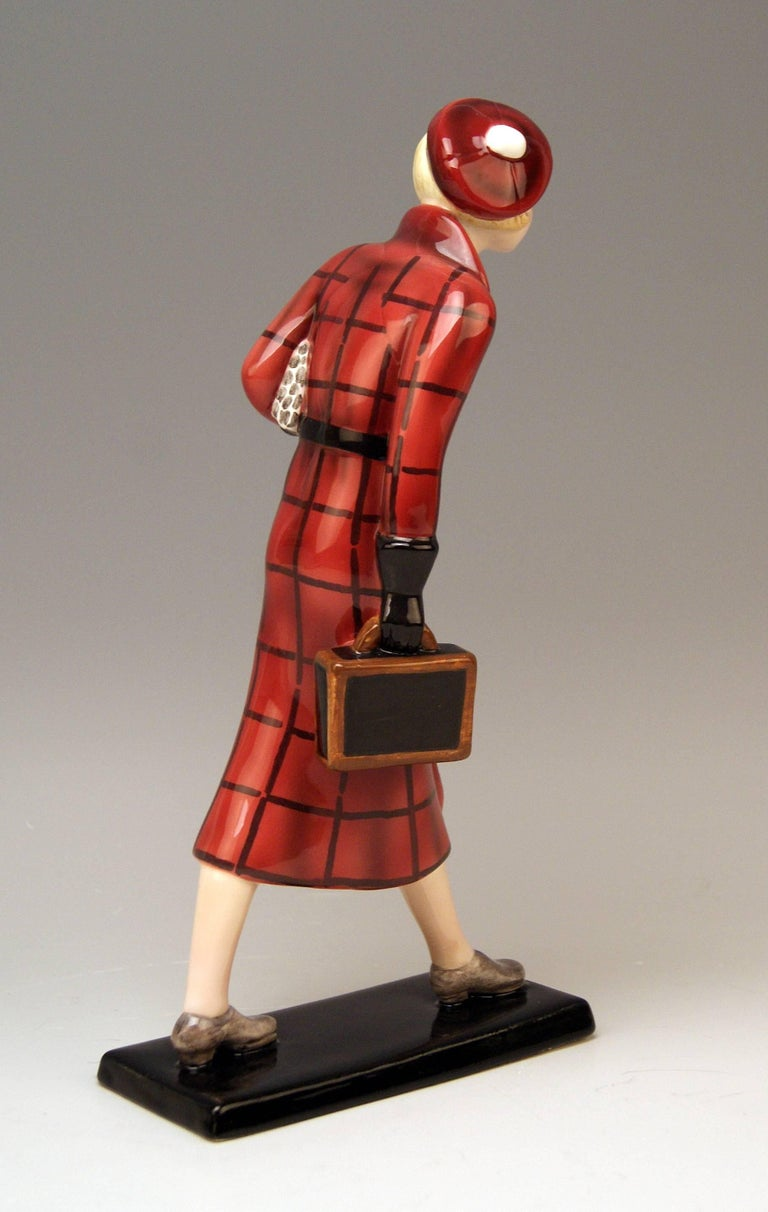 Goldscheider Vienna rarest lady figurine: The traveller with small suitcase.  Possibly designed by Josef Lorenzl (1892-1950) or Stefan (= Stephen) Dakon (1904–1997). Lorenzl was one of the most important designers having been active for