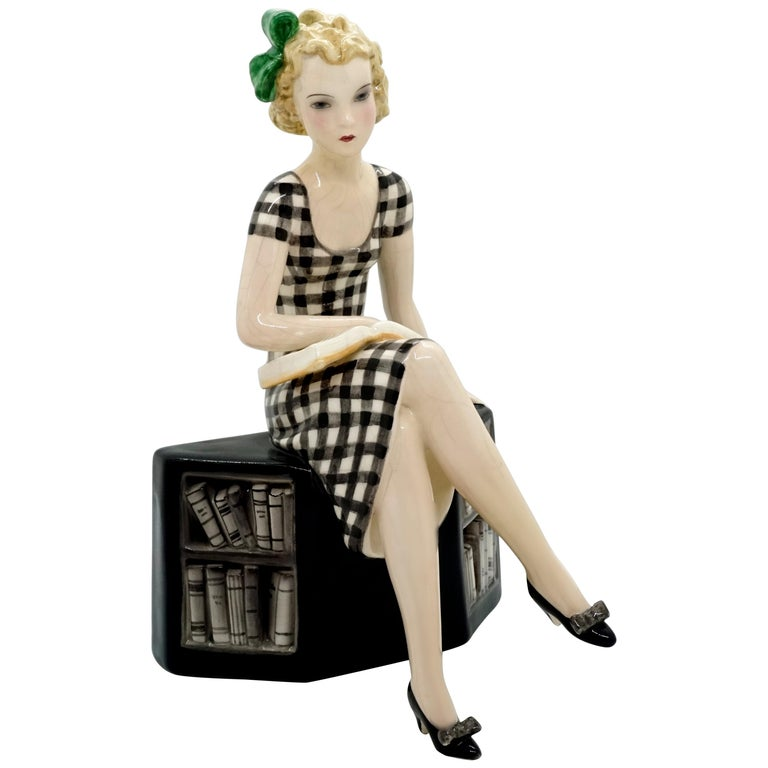 Goldscheider Vienna Girl with Book Sitting on a Bookshelf by Dakon, circa 1935