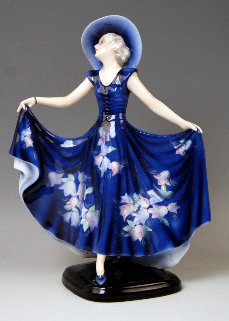 Goldscheider Vienna lady dancer liane wide-brimmed hat clad in blue dress.  Designed by Josef Lorenzl (1892-1950) / one of most important designers having been active for Goldscheider manufactory in period of 1920-1940 / designed, circa