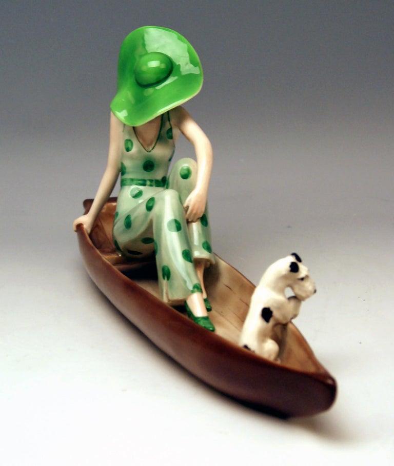 Austrian Goldscheider Vienna Lady with Fox Terrier in Canoe Model 7256 Dakon, circa 1936