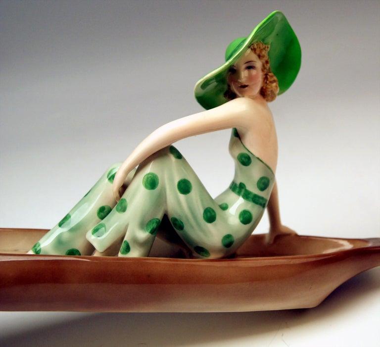 Painted Goldscheider Vienna Lady with Fox Terrier in Canoe Model 7256 Dakon, circa 1936