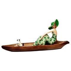 Goldscheider Vienna Lady with Fox Terrier in Canoe Model 7256 Dakon, circa 1936