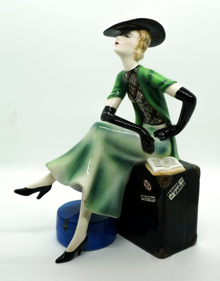 Hand-Painted Goldscheider Vienna Lady with Hat Sitting on a Suitcase by Stephan Dakon, 1935 For Sale