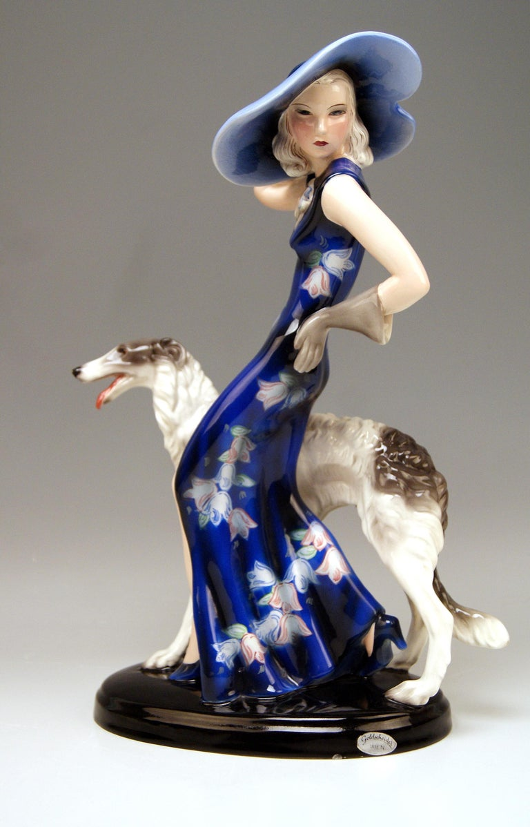 Elegant Lady Wearing A Hat with Broad Brim, Accompanied by A Borzoi Dog