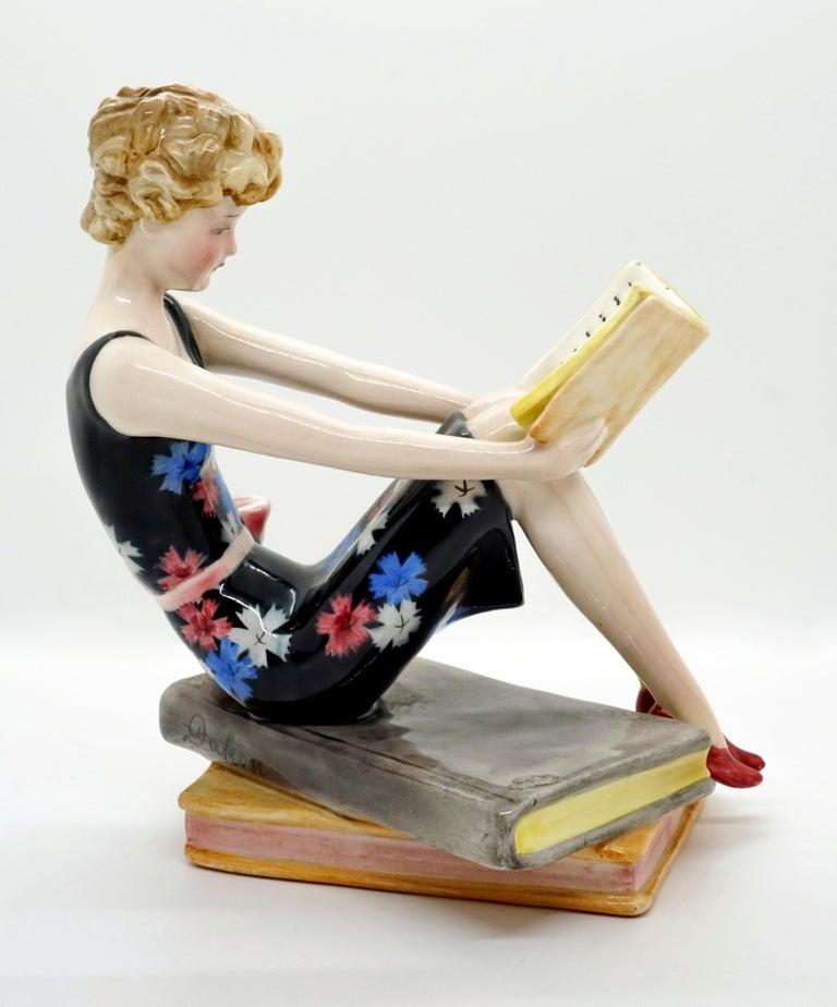 Austrian Goldscheider Vienna Seated Reading Young Lady on Book Base by Dakon, circa 1936
