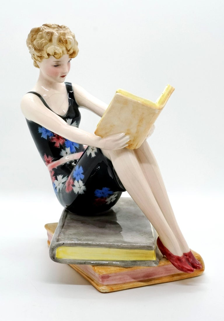 Hand-Painted Goldscheider Vienna Seated Reading Young Lady on Book Base by Dakon, circa 1936