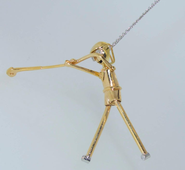 Contemporary Golfer Pendant in Gold with Diamonds For Sale