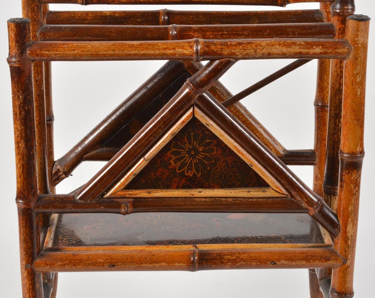 The traditional English Canterbury in the chinoiserie version made of bamboo with triangular decorated japanned lacquer panels. This one dates to the late 19th century and is in great condition.