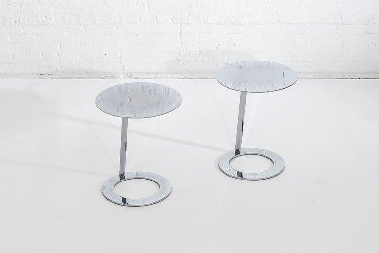 Good morning pedestal tables by Ligne Roset. Minimalist form from polished steel.