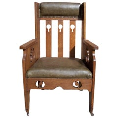 Goodyers of Regent St. an Arts & Crafts Oak Armchair with Stylized Decoration