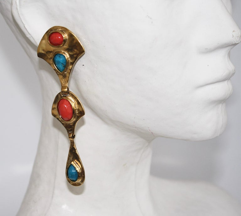Byzantium inspired earrings, made of metal plated in 24K gold bath, decorated with turquoise and coral cabochons.