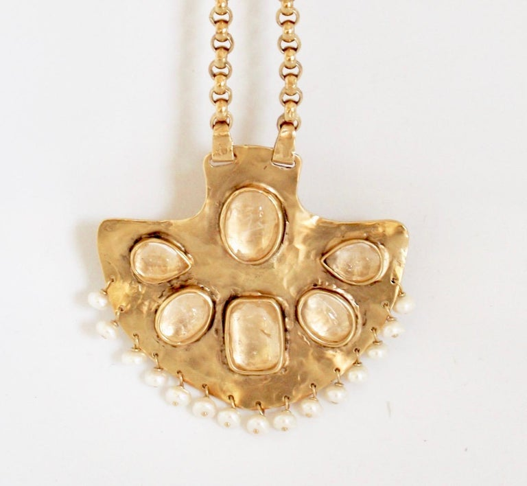 Gold-toned brass pendant necklace from Goossens Paris with natural pearls and rock crystals on chain.   Pendant is 3
