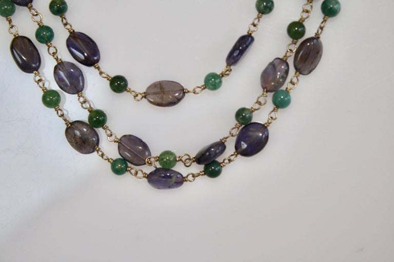 Graduated length triple strand necklace in Iolite and rock crystal from Goossens Paris.