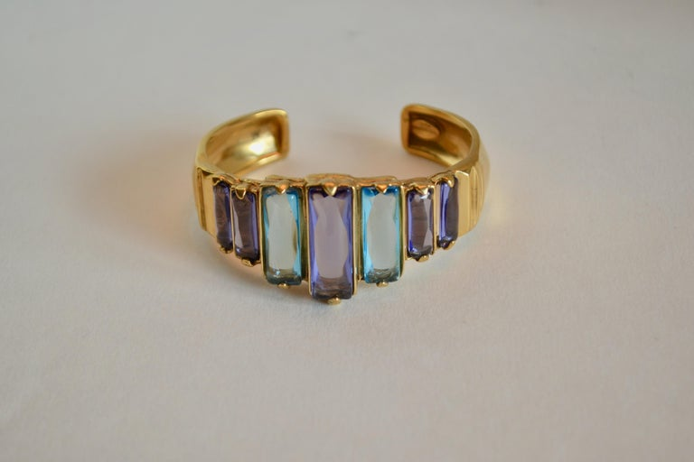 Tinted rock crystal and gold plate cuff bracelet from Goossens Paris. Cuff is malleable and can be worn on both small and large wrists.