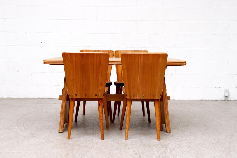 Beautiful Göran Malmvall midcentury pine trestle dining table with double leaf extensions. In original condition with wear consistent with its age and use.