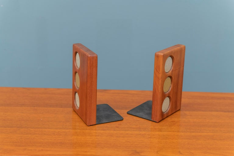 Gordon and Jane Martz bookends for Marshall Studios. Signed with manufacturer's label, made from black walnut and inlayed multicolored ceramic circles.