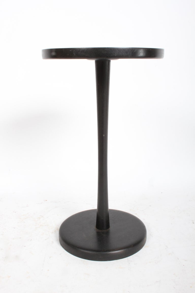 Gordon Martz for Marshall Studios round tile top pedestal or side table with original dark stain. Nice all original condition, some minor scuffs and wear to wood, no damage to round golden colored ceramic tiles. Has weighted cast metal base