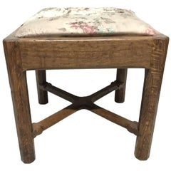 Gordon Russell, an Arts & Crafts Cotswold Oak Stool with Carved Cross Stretcher