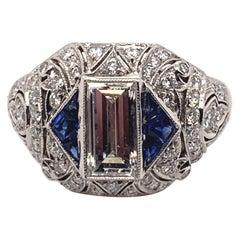 Gorgeous 0.94 Carat Platinum Center Baguette Cut Diamond Sapphire Ring