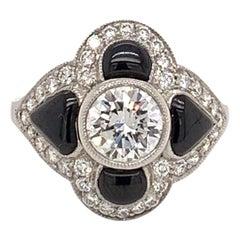 Gorgeous 0.96 Carat and Platinum Center Diamond Onyx Ring