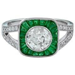 Gorgeous 1.08 Carat Platinum Center Round Diamond and Emerald Ring
