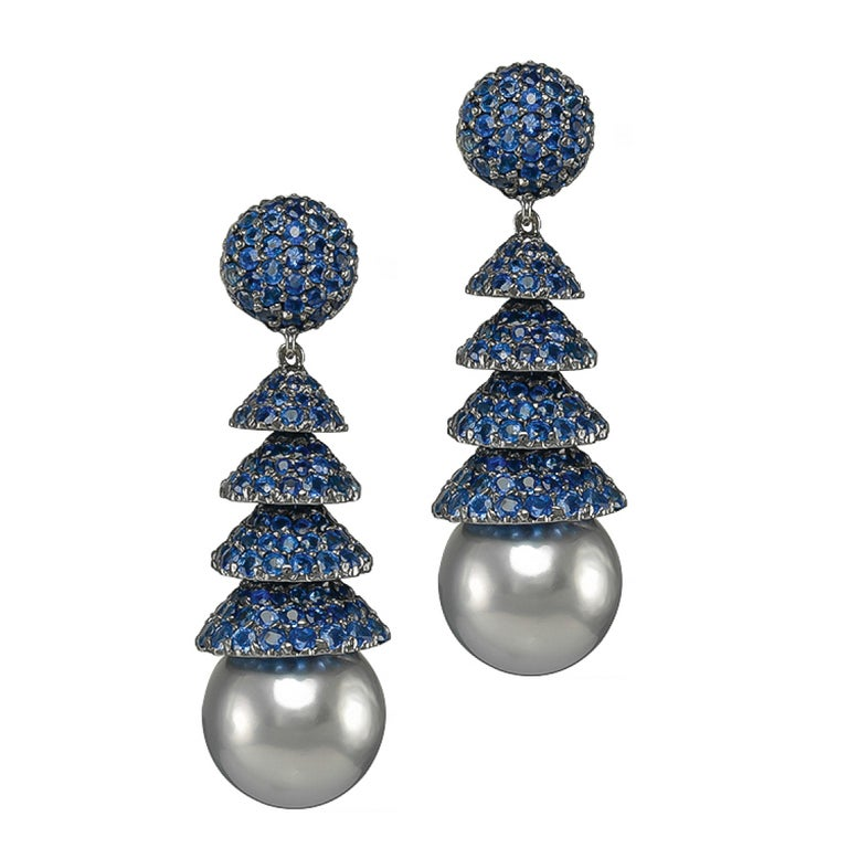 Pair of 18K White Gold consist of BlueSapphires 16.16 carats withBlackPearls.