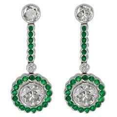 Gorgeous 2.27 Carat Center Round Platinum Emerald Diamond Earring
