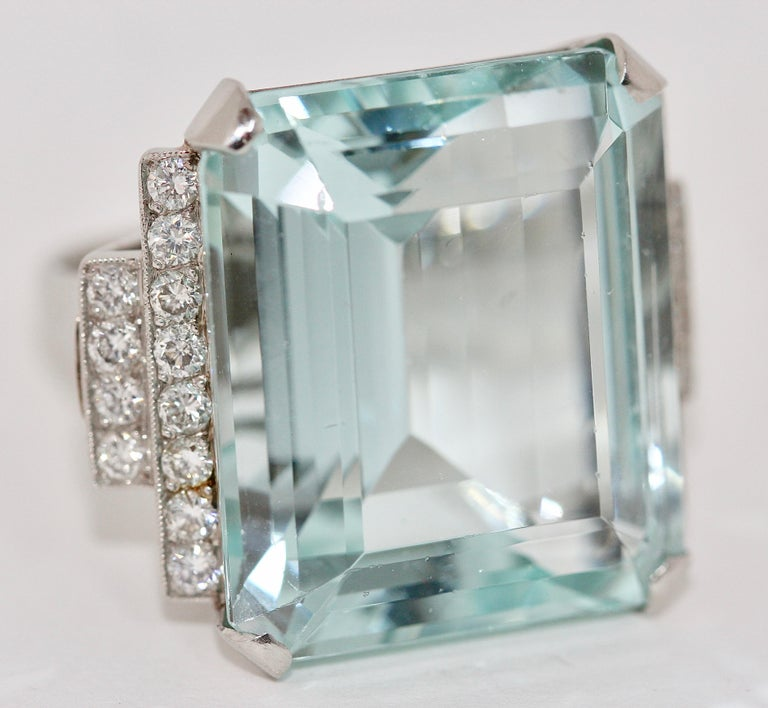 Gorgeous 950 platinum ring with large faceted aquamarine and 24 diamonds in TOP quality.  The dimensions of the aquamarine are L 22.3 x W 19.17 x H 11.91 mm.